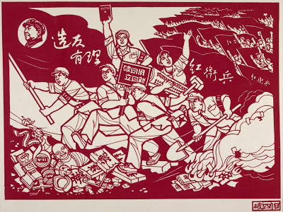 Among a sea of red flags and soldiers, a red guard holds a sign which reads 'do away with the four olds, cultivate the four news'