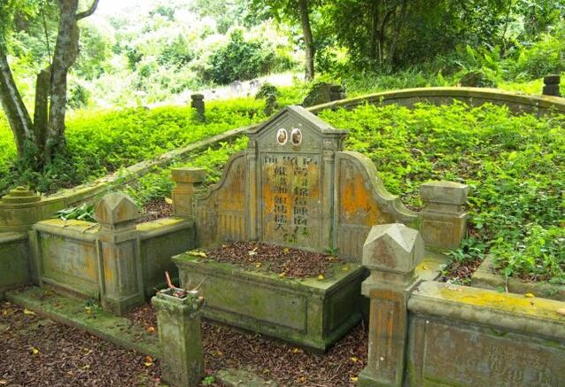 Overgrown traditional Chinese gravestone in Singapore