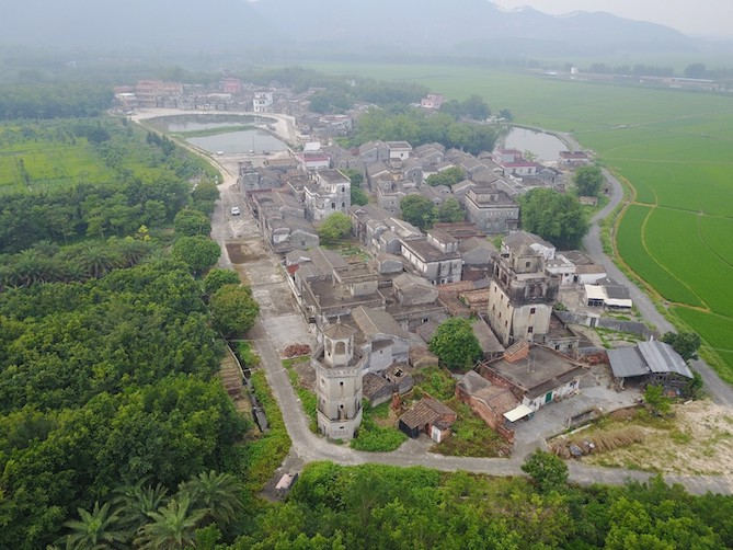 A birdseye view of a Chinese village surrounded by greenery