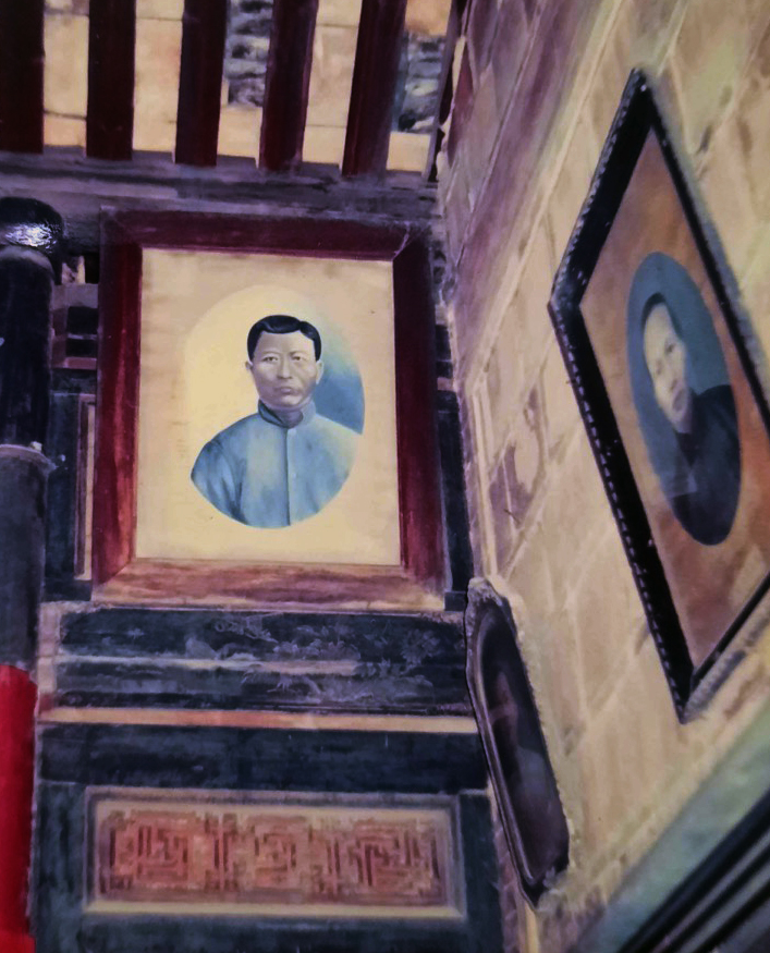 Painted portrait of a Chinese ancestor hanging in an ancestral temple