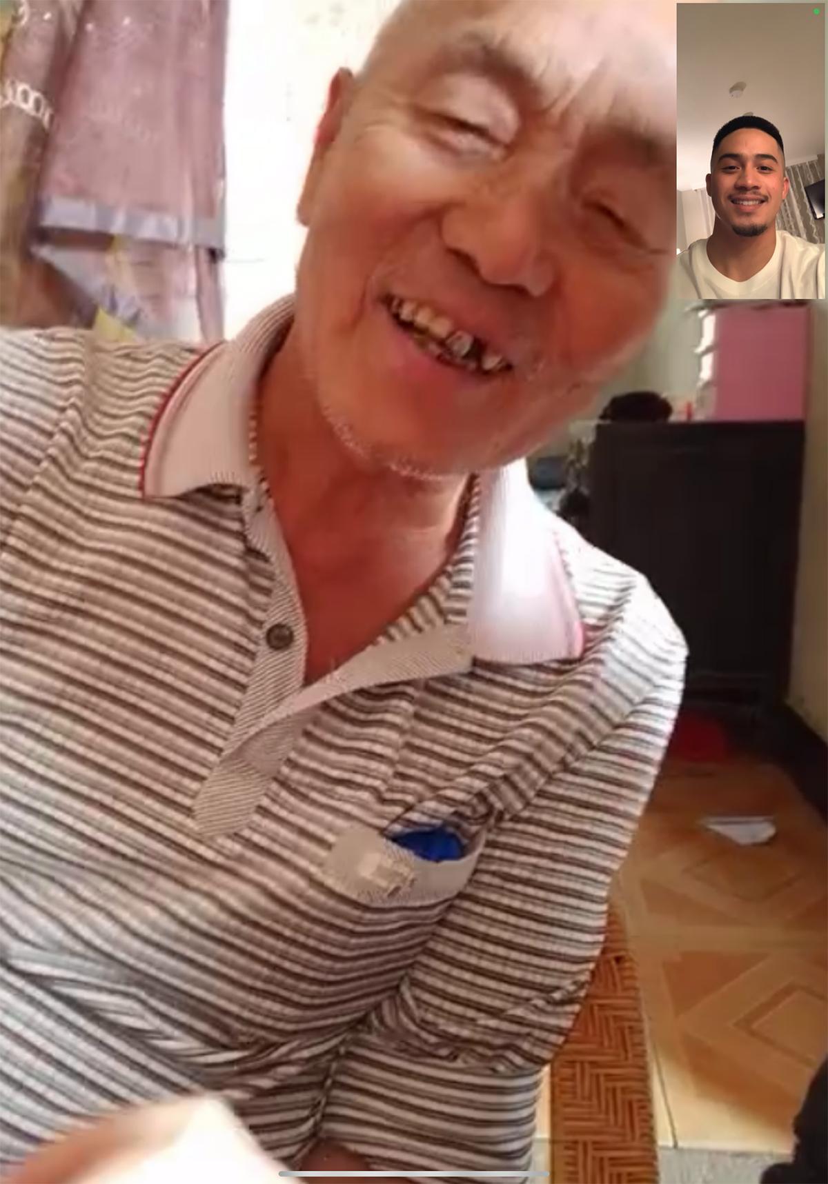 Screenshot of smiling elderly Chinese man meeting young Filipino Chinese man on FaceTime